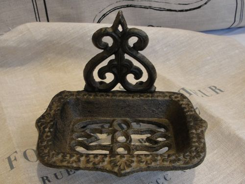 Dark cast iron soap dish